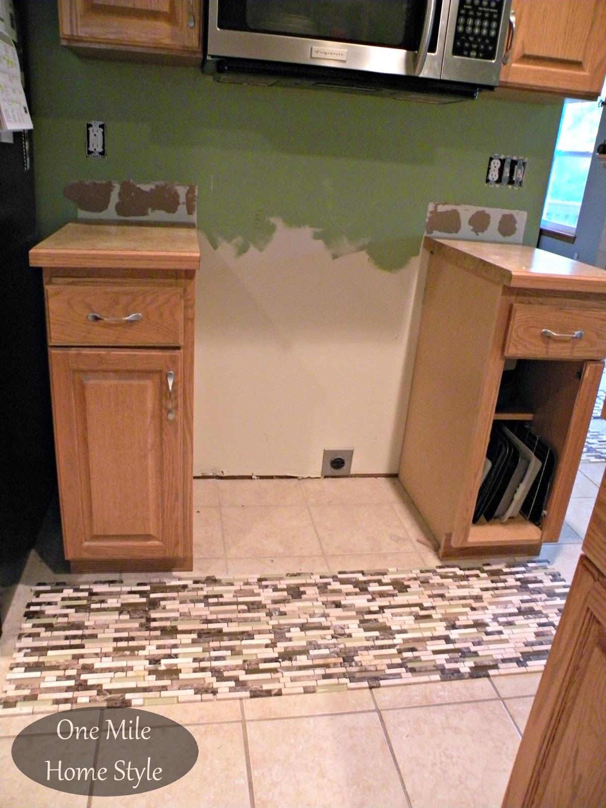 Laying out the backsplash tiles