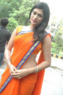 Shraddha Das Spicy saree Lovely Orange Sleeveless Blouse Low Rise Saree Must See Beauty