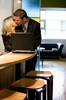 Copuple kisses at computer