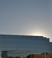 photo of sun setting behind office building