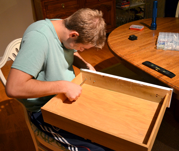Finn is working to attach the hardware to our new TV console!