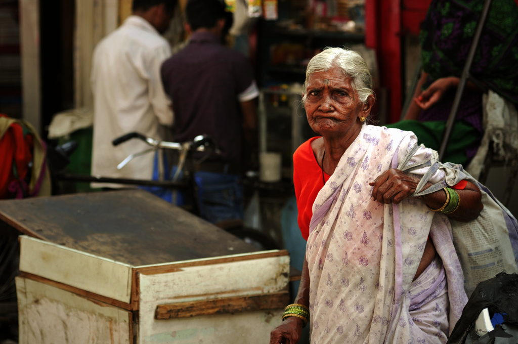 This is an India photo of an old woman in Mumbai
