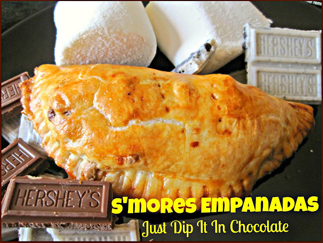 S'mores Empanadas Recipe, looking for a season round alternative to S'mores, this little pastry pillows have all the goodness of your typical S'more but no need to camp out for them! 4 Ingredients and enjoy!