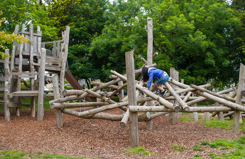 Climbing the log maze in kimberly gardens Falmouth, conrwall, England