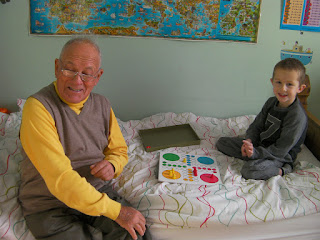 boy playing ludo with grandad