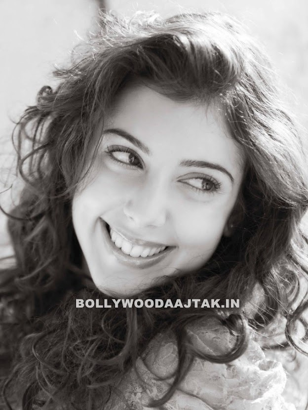 Anisa wears a big smile with some puffy curly hair - (3) -  British Indian Actress Anisa Photoshoot