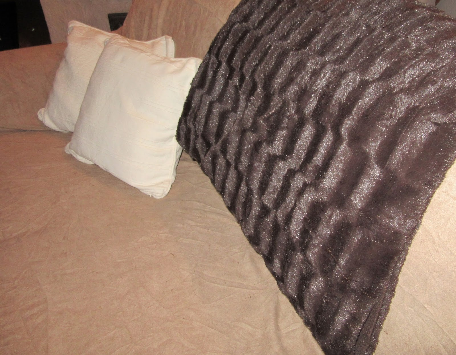 Brown blanket and white pillows on the sofa