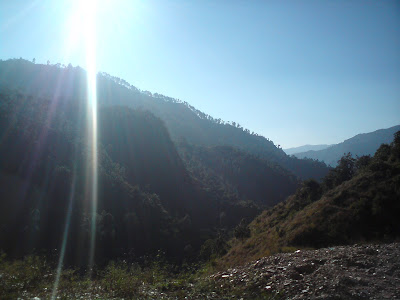 Sun, mountains and sunrise in the Garhwal Himalayas