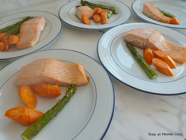 kid and adult portions of salmon, asparagus and carrots