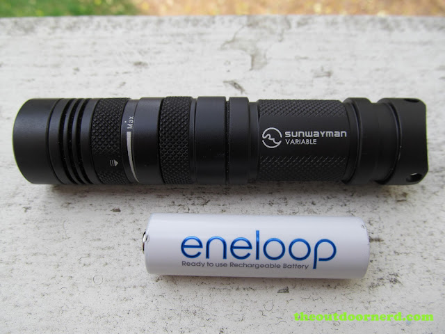 Sunwayman V11R AA battery extender tube next to Eneloop