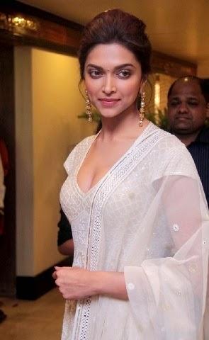 Deepika Padukone in her tight dress exposing her big huge round cleavage