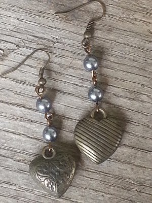 assemblage earrings with brass hearts and blue pearls