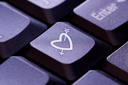 picture of a keyboard and on the key next to enter is a heart with an arrow through it