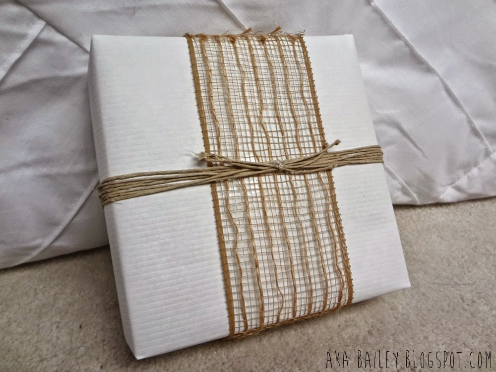 White gift wrap with burlap ribbon and hemp twine