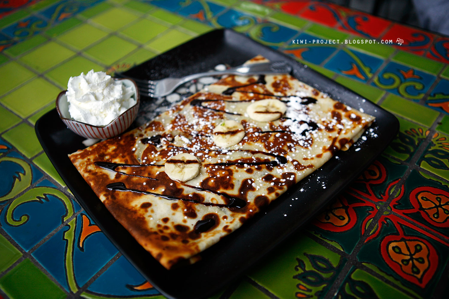 banana nutella crepe banana with nutella topped with whipped cream