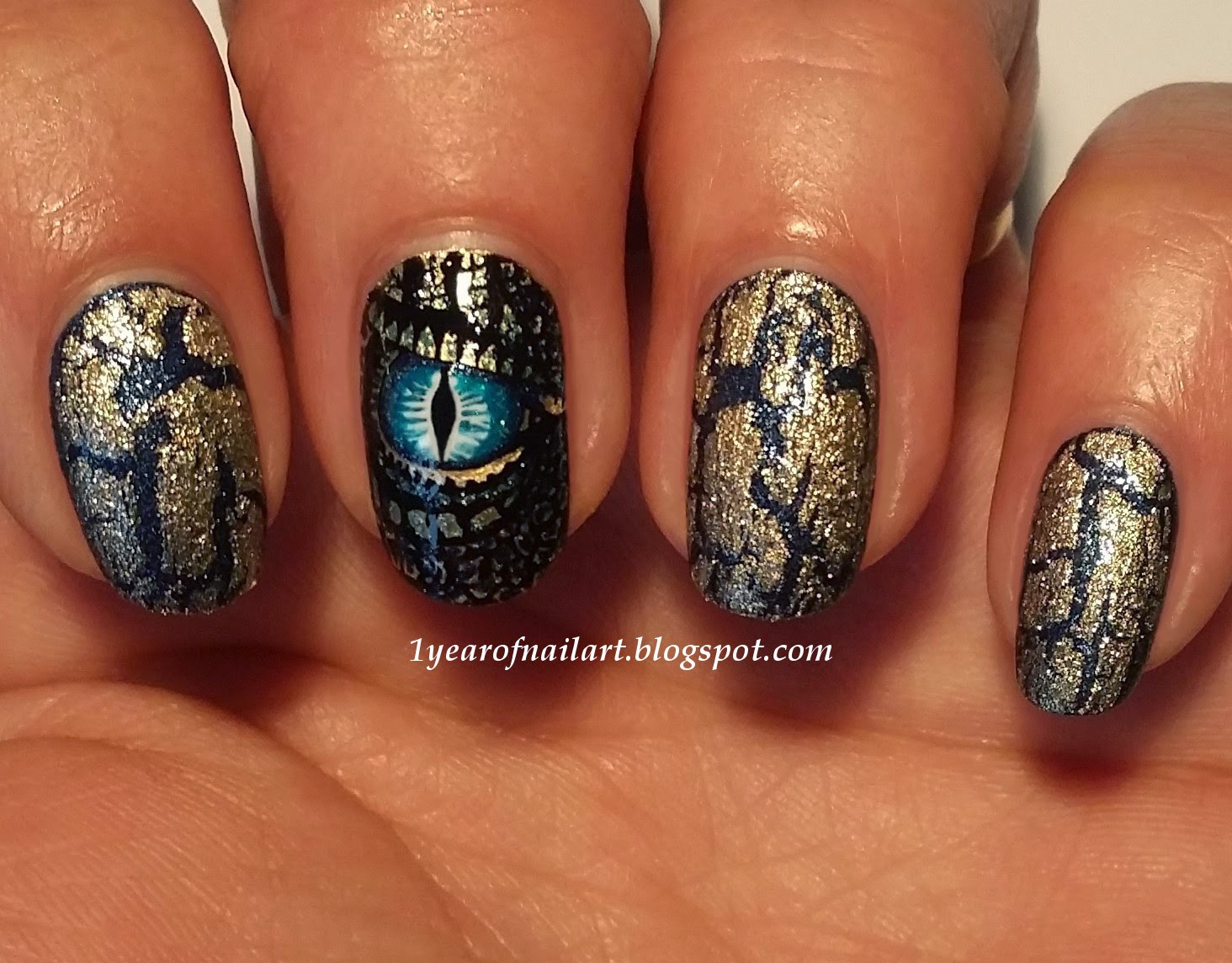 Polishes used: - 365+ Days Of Nail Art: Blue And Gold Dragon Nails