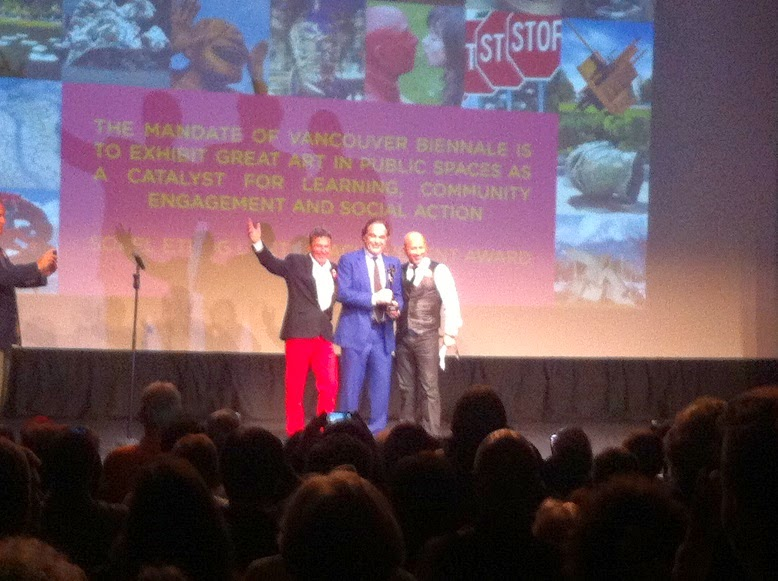 Oliver Stone receiving award in Vancouver talk