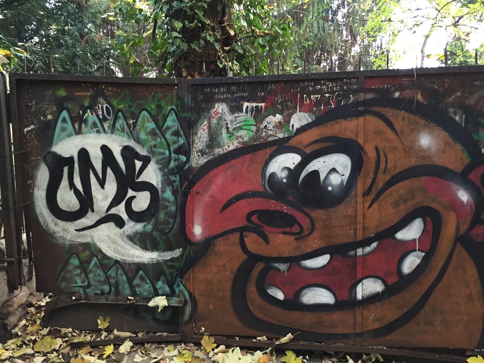 travelmarx bergamo street art faces on walls fish pirate friendly monster