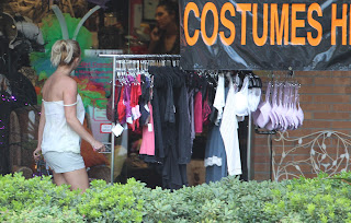 Britney Spears standing in front of a    Halloween store