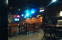 Interior tables and TV Gabriel's Pizza in Cleveland, Tennessee