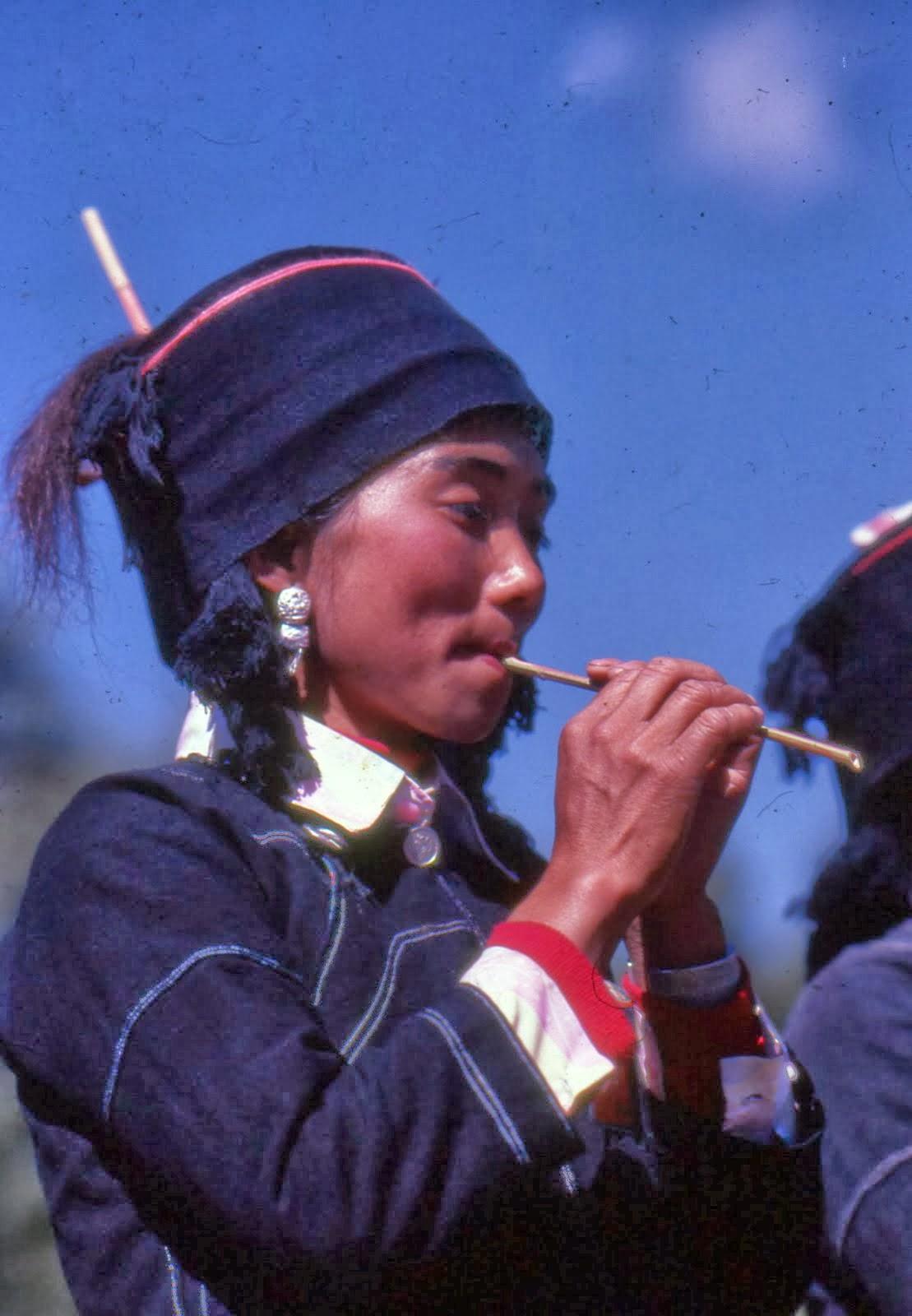 Hani girl on flute