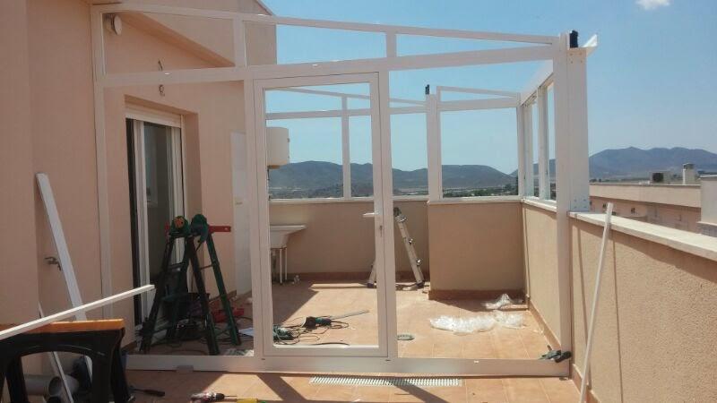 Cerramiento de terraza en puerto lumbreras cerramientos for Techos de teja para terrazas