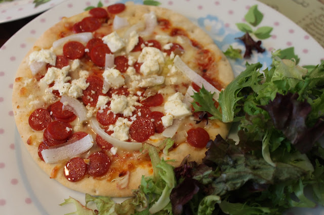 pepperoni, onion and feta pizza with side salad