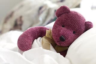 cute-sad-teddy-bear-in-bed-feeling-warm-picture.jpg