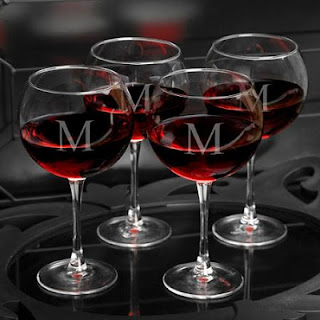 http://abitofwine.com/item_6/Set-of-4-Personalized-Red-Wine-Glasses.htm