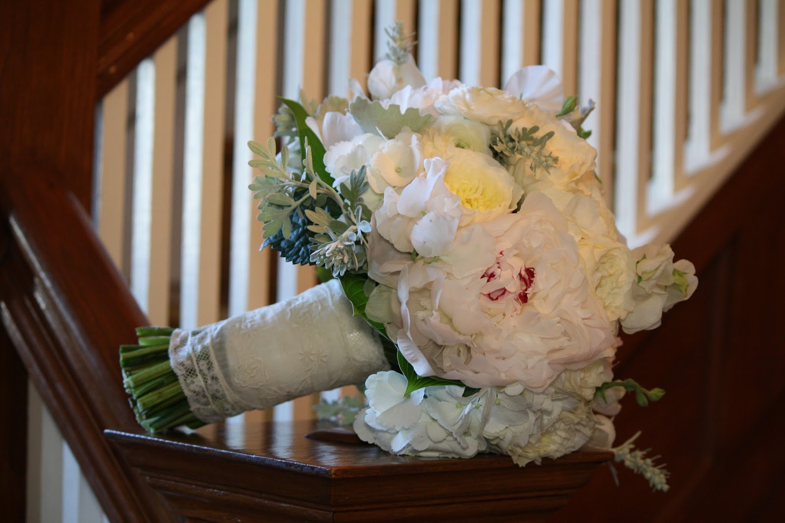 Cream Garden Rose and Peony Bride Bouquet - Elegant, yet natural, hand-tied bouquet composed of white peonies, cream garden roses, white sweet peas, white ranunculus and dusty miller