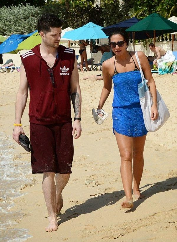 Sporting a beaming smile at Barbados on Wednesday, December 31, 2014, Tulisa Contostavlos appeared to be channeling on unforgotten style.