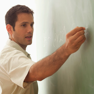 Math Teacher Writing on Chalk Board by cybrarian77 on Flickr