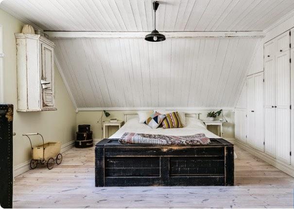 Dormitorio principal con lámpara colgante