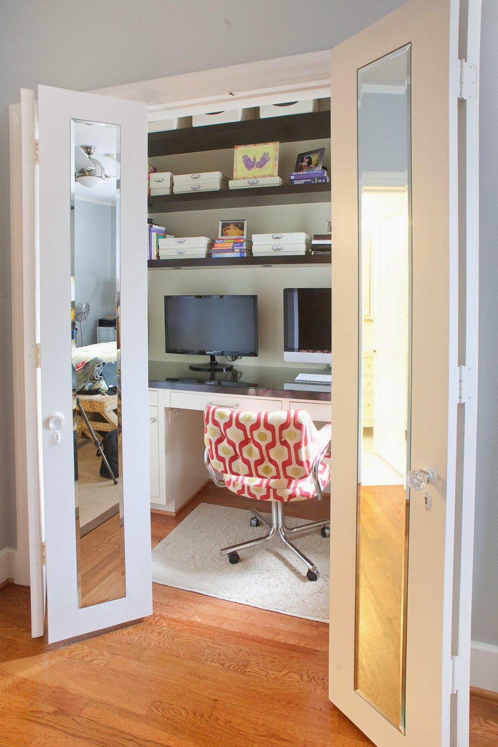 mirrored bifold hanging closet doors idea