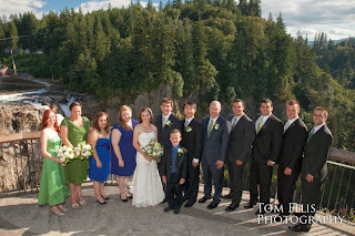 The wedding party of Shaina and Thomas stand before Snoqualmie Fall - Kent Buttars, Seattle Wedding Officiant