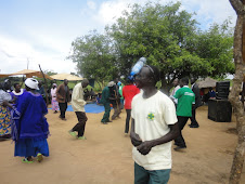 A VHT demonstrating a mobile tippy tap during a dram in Apobo village