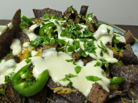 Steak and Beer Cheese Nachos side