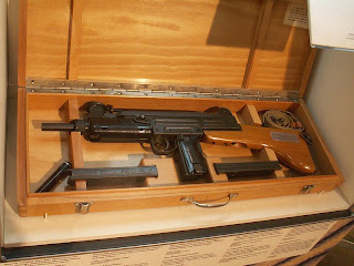 Uzi submachine gun with fixed wooden buttstock