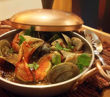 Copper serving dish with cioppino