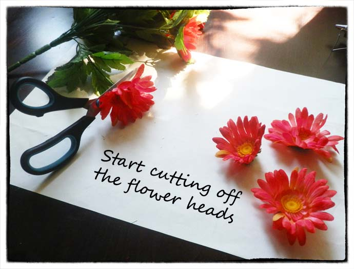 DIY project step 1: Start cutting off the flower heads using the scissors