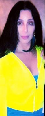 Cher in a bright yellow tracksuit top