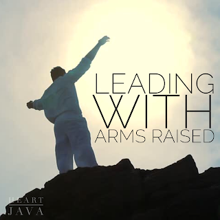 leading with arms raised