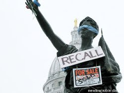 Forward statue with 'Recall' sign