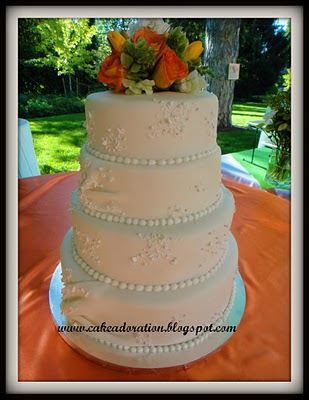 This elegant White Wedding Cake was patterned after the Brides Wedding Dress
