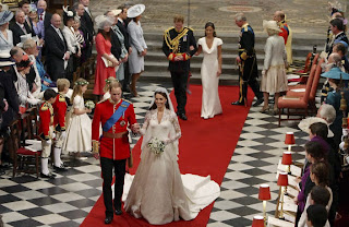 Britain's Prince William and his wife Catherine, Duchess of Cambridge, walk up the aisle, followed by Prince Harry and Maid of Honor Pippa Middleton