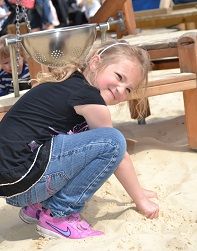 Playing in the sand @ ups and downs smiles and frowns