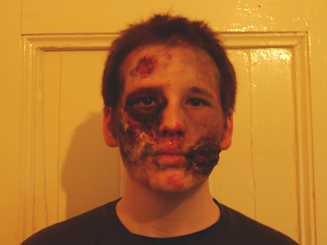 Guy with zombie makeup on.