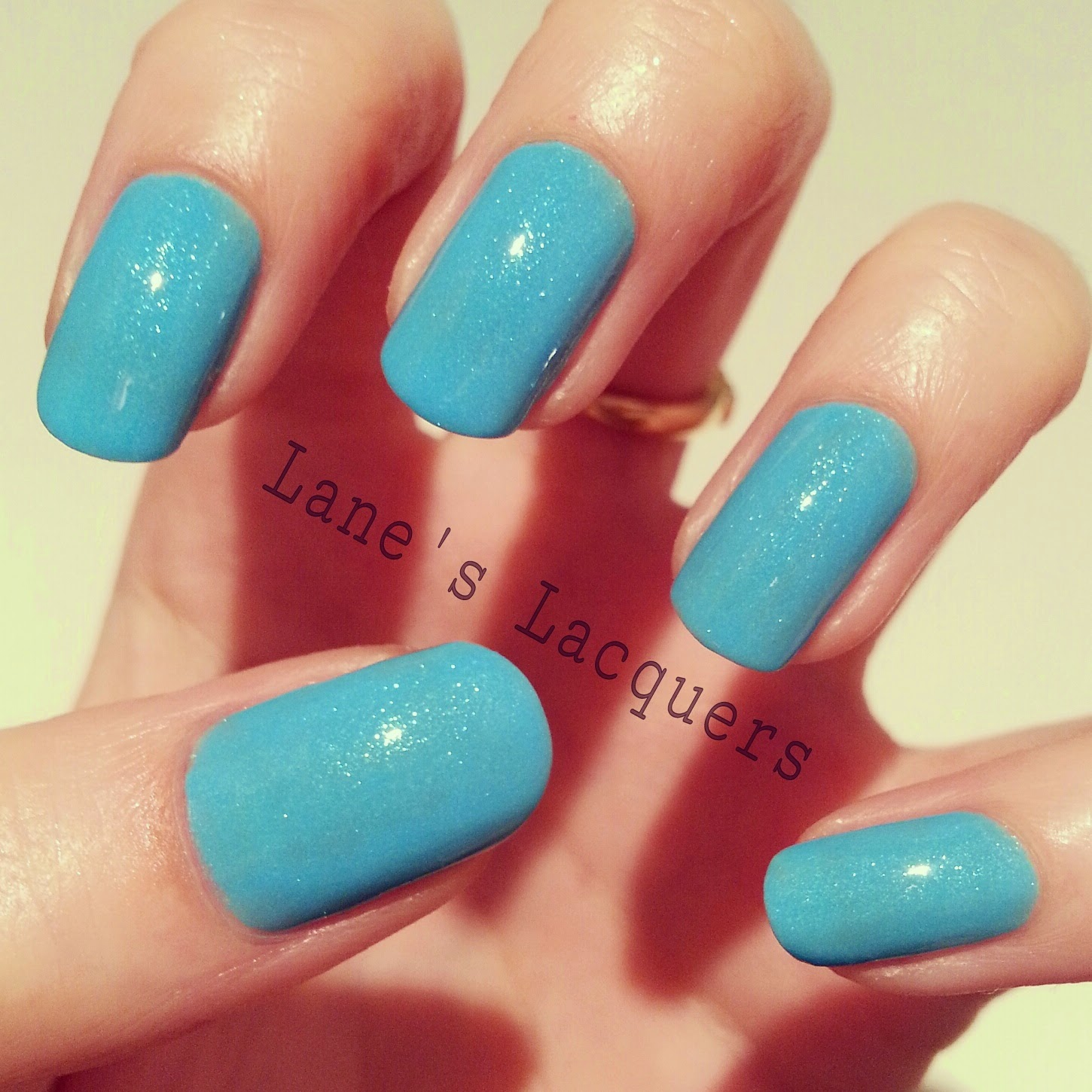 new-models-own-luxe-collection-asschure-blue-swatch-manicure