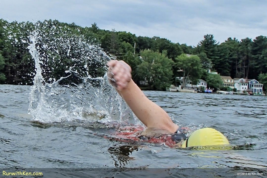Up-close action photo of a triathlete, open water swimming at the Triathlon at Lake Pearl in Wrentham, MA. Sports Photography from Inside the Pack by Ken Skier, the Swimming Photographer. (RunwithKen.com)