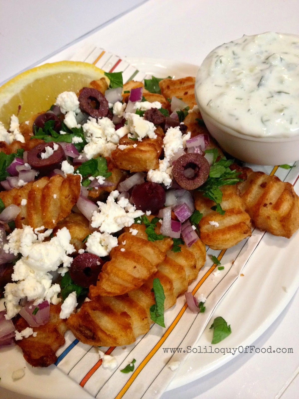 Greek Fries ~ Now fries are a meal!  www.SoliloquyOfFood.com via LoveBakesGoodCakes.com